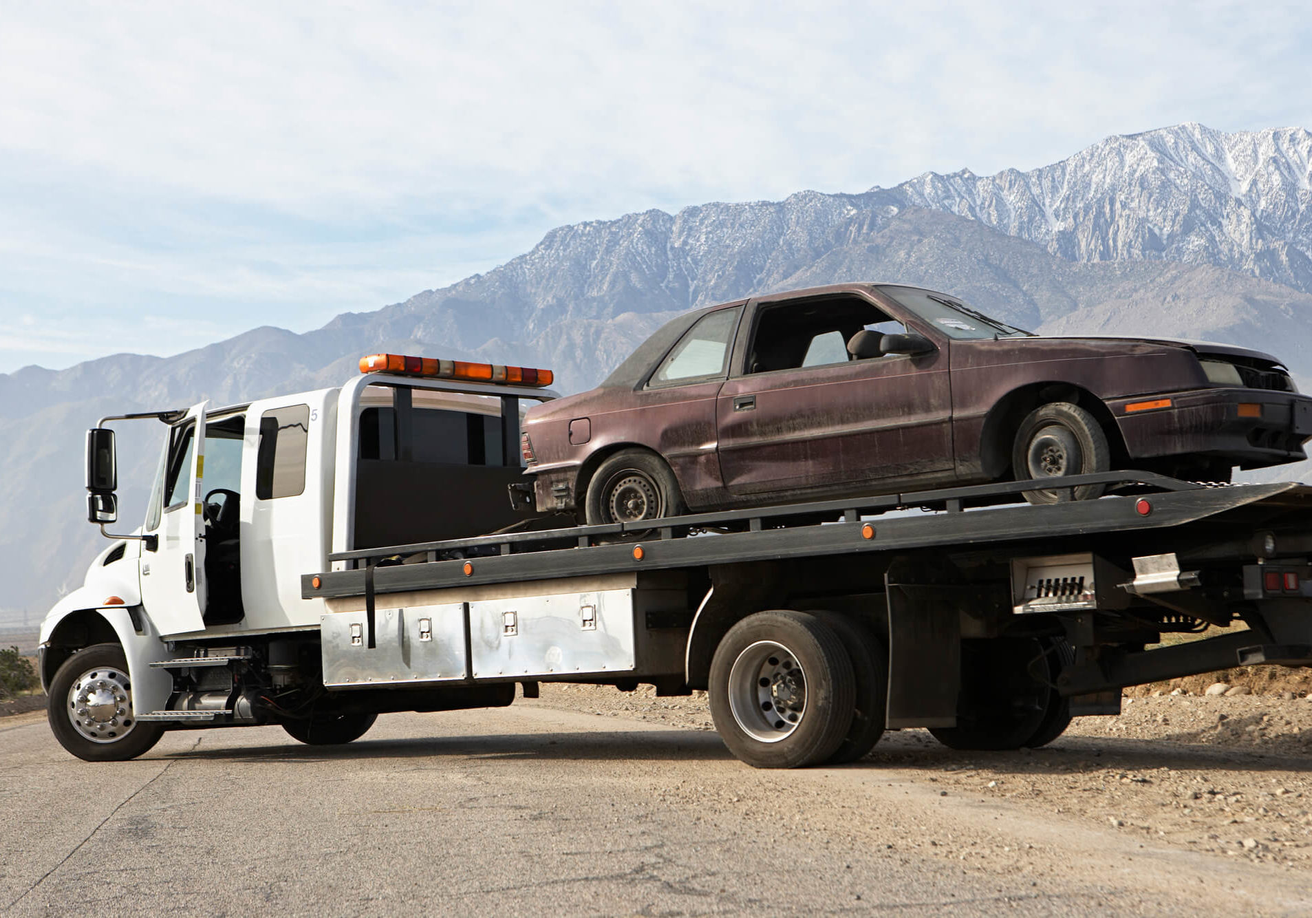 Towtruck Flatbed Across Road Mountains